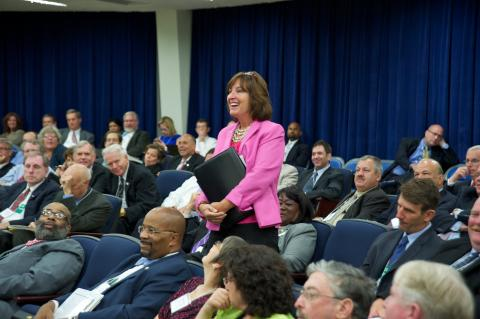 Photo of participant asking question at White House event.